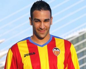 Valencia's new soccer player Adil Rami of France poses during his official presentation in Valencia